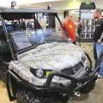 The new John Deere XUV-S4 four passenger UTV is big,  as illustrated by this excited customer.