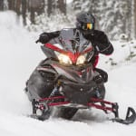 The Apex along with the Vector and Venture snowmobiles return unchanged for 2015. A new matte black scheme is found across all the models.