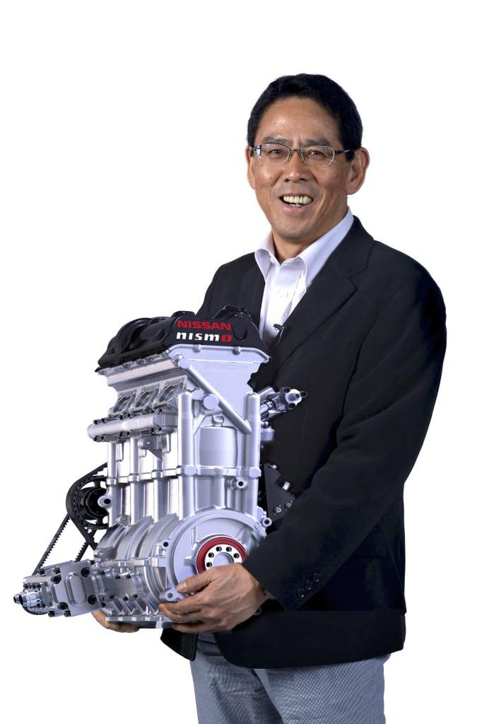 NISMO President Shoichi Miyantani is shown here holding the 88-pound 400-horsepower engine.