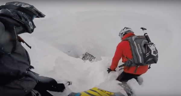 Watch This Guy's Sled Get Swallowed Up