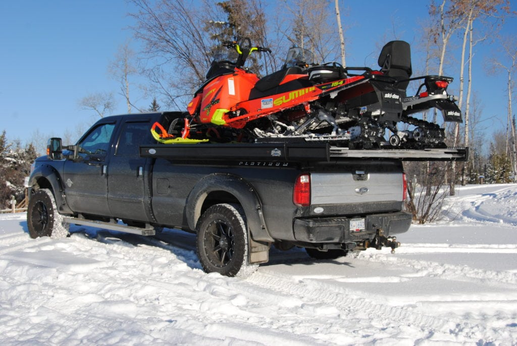 With easy sliding expandable sides, the Xplore truck deck can be expanded to fit two sleds or a side-by-side, and then easily pushed back in, retaining the standard width of your truck for everyday use.