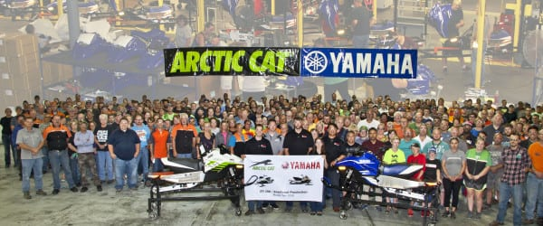CAT AND YAMAHA CELEBRATE AS FIRST ZR200 AND SNOSCOOT ROLL OFF THE LINE